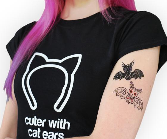Sugar skull bat tattoo